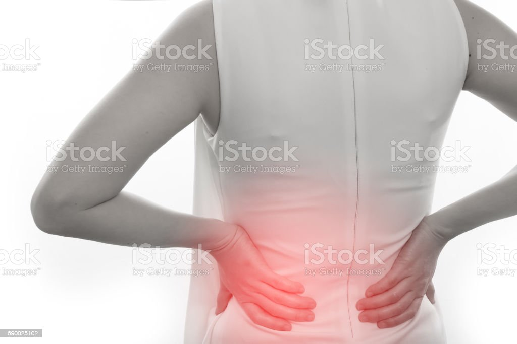 woman having Low and Lower Back Pain on isolated white background. stock photo