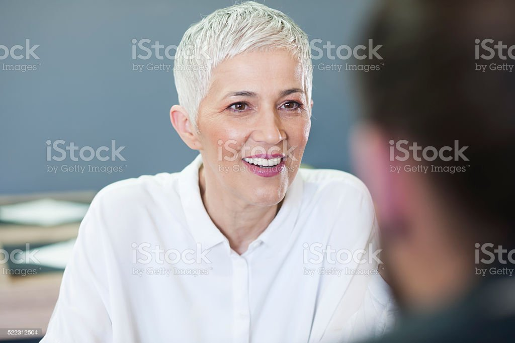 Woman having lunch at a restaurant with friends stock photo