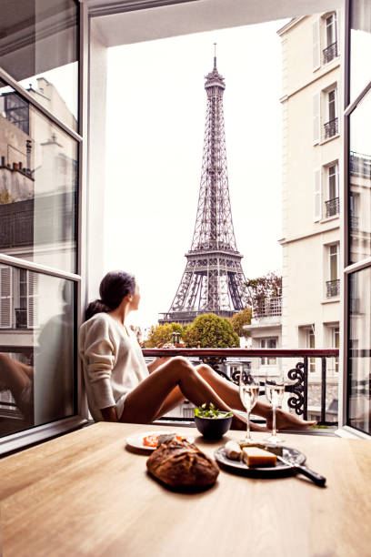 Woman having lunch in hotel in Paris Woman having breakfast in hotel in Paris. The image is a composition. french culture stock pictures, royalty-free photos & images