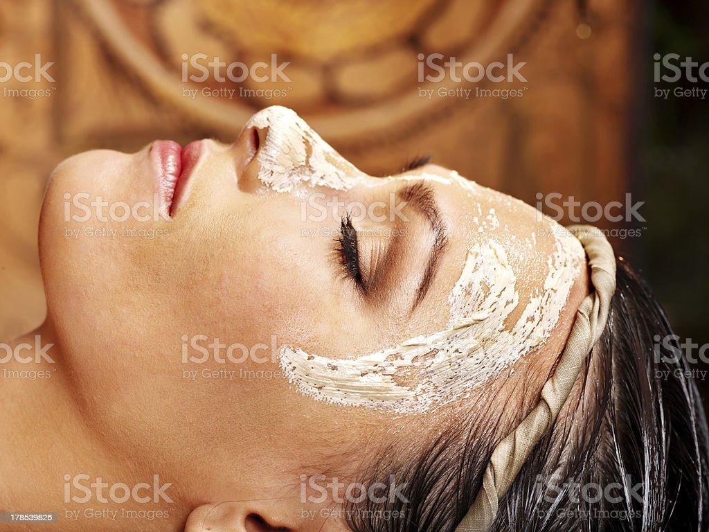 Woman having mask at ayurveda spa royalty-free stock photo