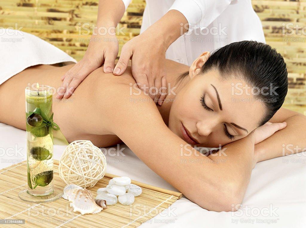 Woman having massage of body in spa salon royalty-free stock photo