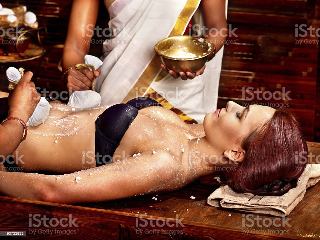 Woman having massage with pouch of rice. royalty-free stock photo