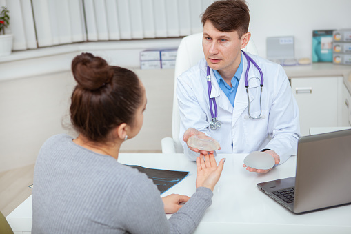 istock Woman having medical consultation with plastic surgeon 1202596058