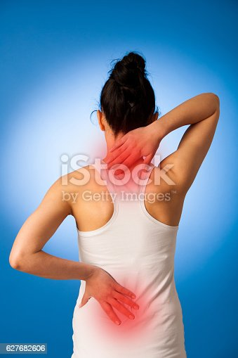istock Woman having pain in her back - back injury 627682606