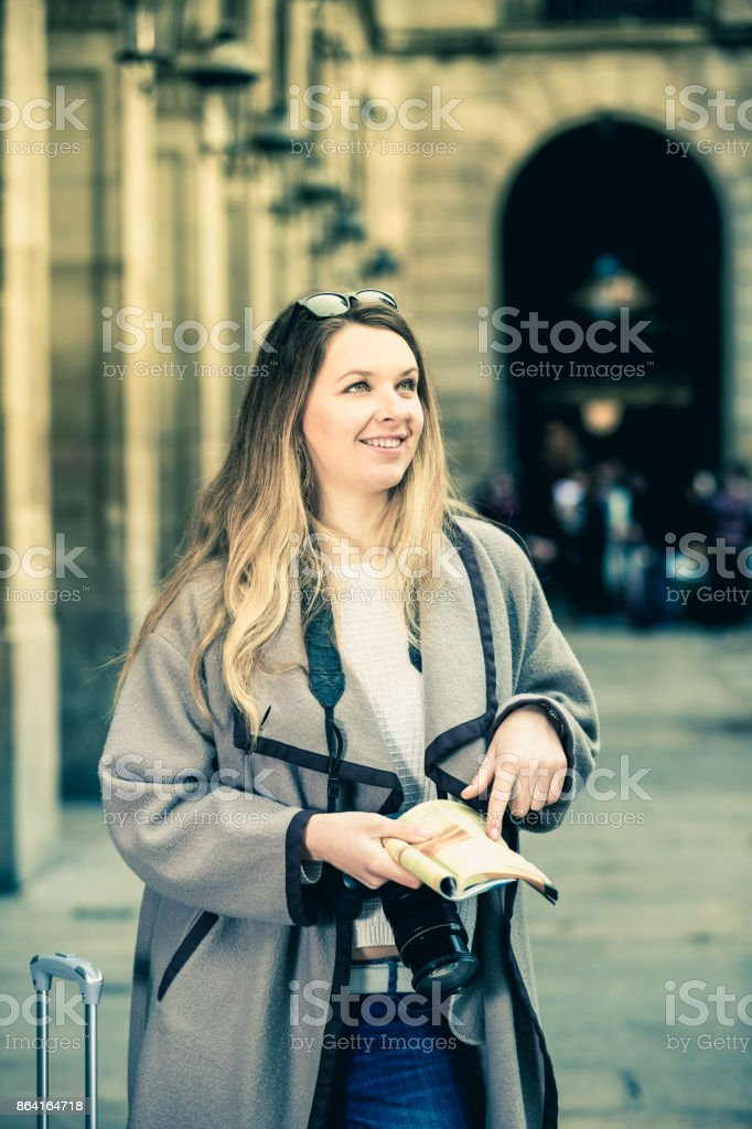Woman having pamphlet and looking for her route royalty-free stock photo