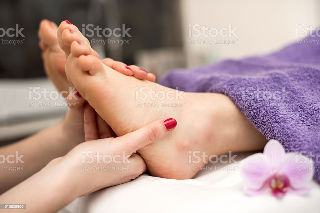 Woman having pedicure treatment at spa or beauty salon stock photo