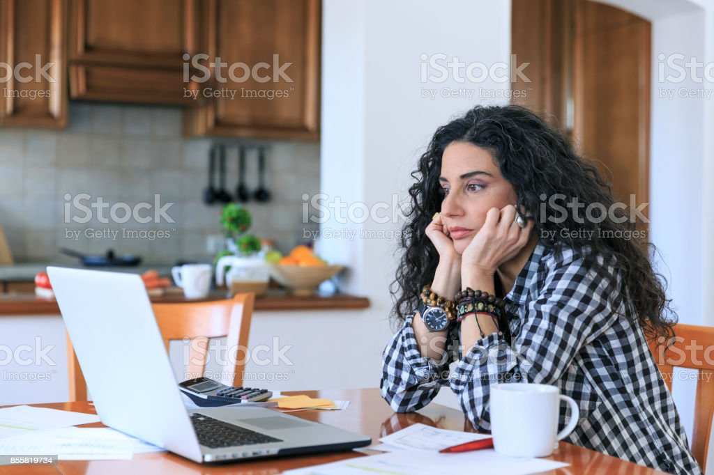 Woman having problems with home bills stock photo