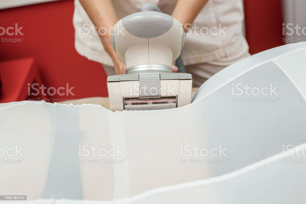 Woman having procedure of anti cellulite lpg massage, cosmetology clinic - foto stock