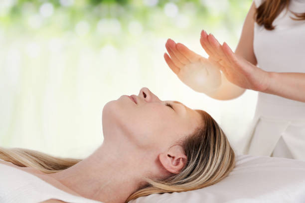 Woman having reiki healing treatment alternative medicine concept picture id1047677178?b=1&k=6&m=1047677178&s=612x612&w=0&h=mu3wu7k3ty2gzta0olg1jdl0hyrkqgzmeun0bfv0ems=