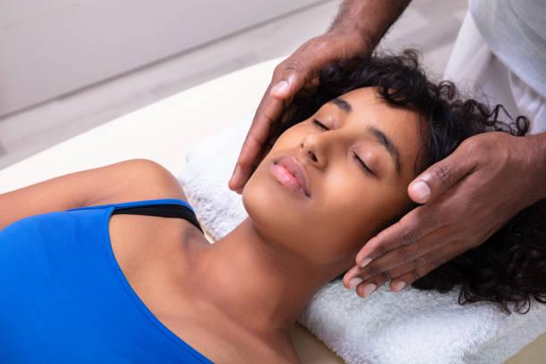 Woman having reiki healing treatment picture id1177797154?b=1&k=6&m=1177797154&s=612x612&w=0&h=nkqpl0rh izevyhsgtcyt4fi1wzhd02kkmoou8rg4le=
