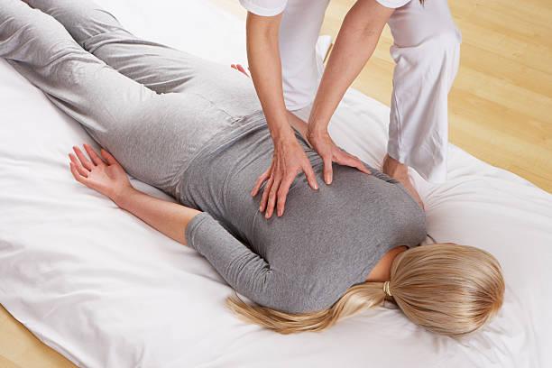 Woman having Shiatsu massage stock photo