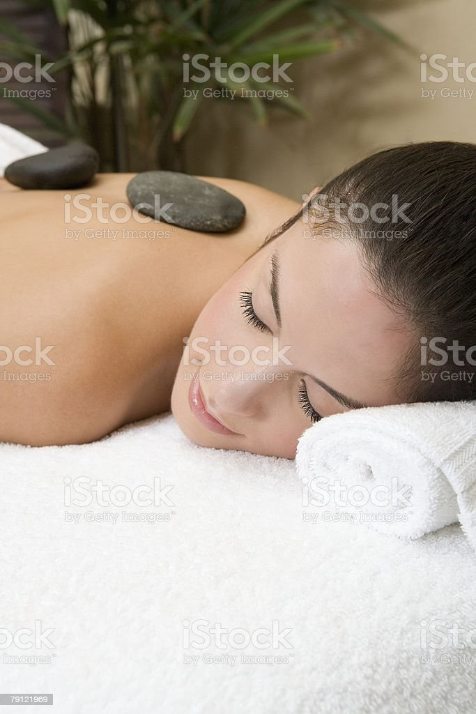 Woman having stone therapy royalty-free stock photo