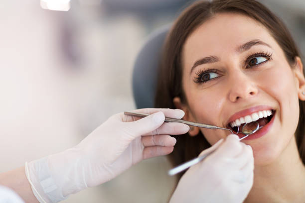 Woman having teeth examined at dentists Woman having teeth examined at dentists dental health stock pictures, royalty-free photos & images