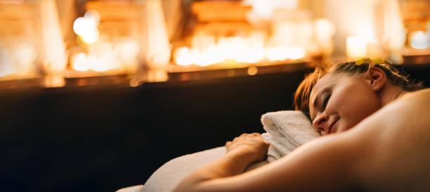 Woman Having Thai Massage Body Care Relaxation stock photo