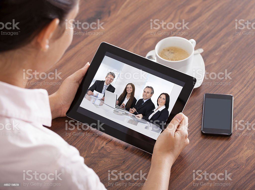 Woman having video conference on tablet stock photo
