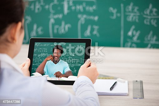 istock Woman Having Videochat On Digital Tablet 473447286
