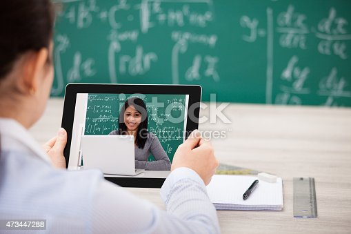 istock Woman Having Videochat With Digital Tablet 473447288