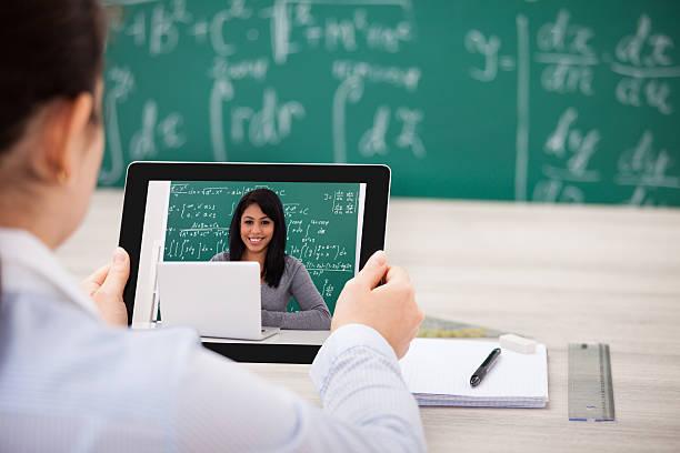 woman having videochat with digital tablet - e learning stockfoto's en -beelden
