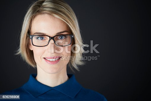 981750034istockphoto Woman headshot looking at camera. 626256908