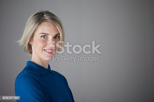istock Woman headshot looking at camera. 626257092