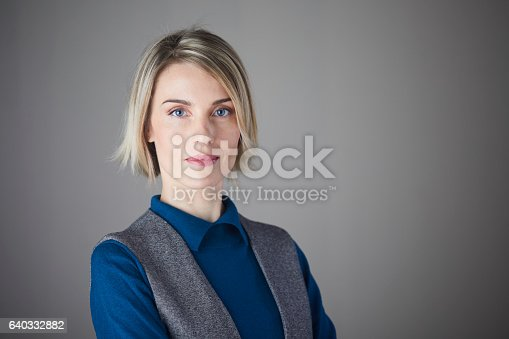 981750034istockphoto Woman headshot looking at camera. 640332882