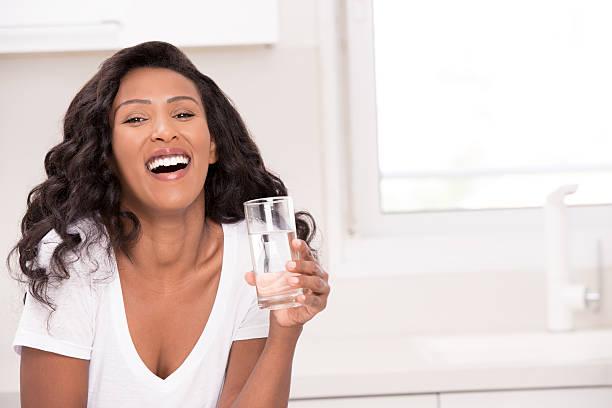 woman healthy drinking. - wasser trinken abnehmen stock-fotos und bilder
