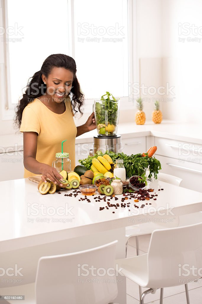 Woman healthy eating/drinking preparation. stock photo