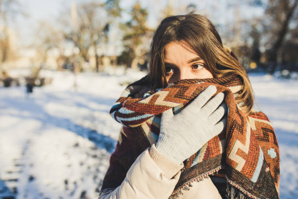 Woman heat herself with scarf outdoor stock photo