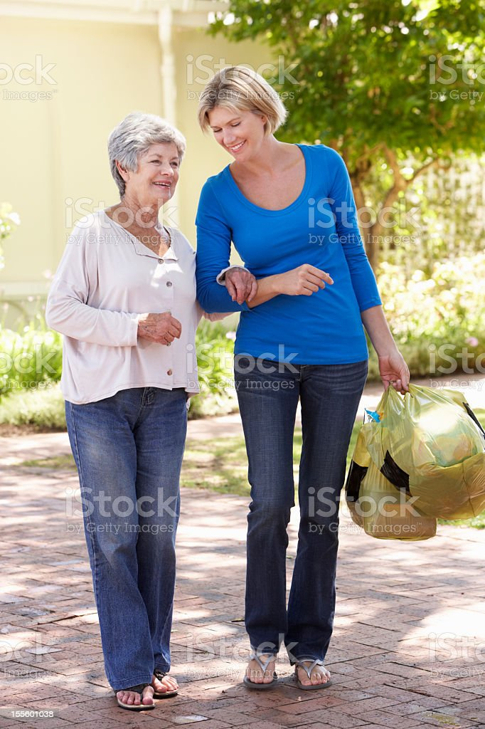 Woman Helping Senior Female With Shopping royalty-free stock photo