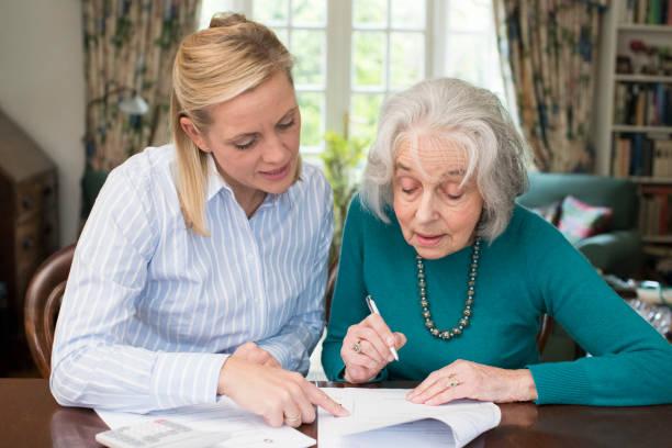 Woman helping senior neighbor with paperwork picture id868904530?b=1&k=6&m=868904530&s=612x612&w=0&h=wz3aggkv3utwvqnwfuhzbx5zlmmlipsvnz55jbglrom=