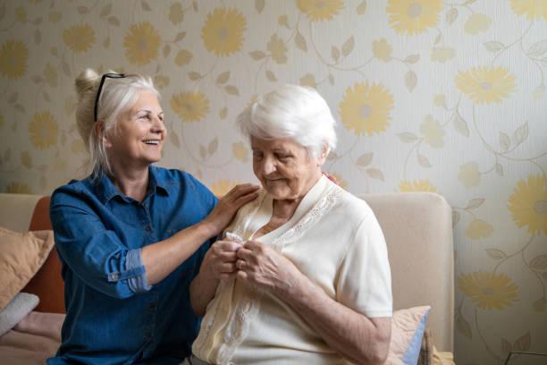 Woman helping senior woman dress in her bedroom picture id1248708332?b=1&k=6&m=1248708332&s=612x612&w=0&h=duzpcgceyjll8riquaznqletgeszqsswnet1snkfwxo=