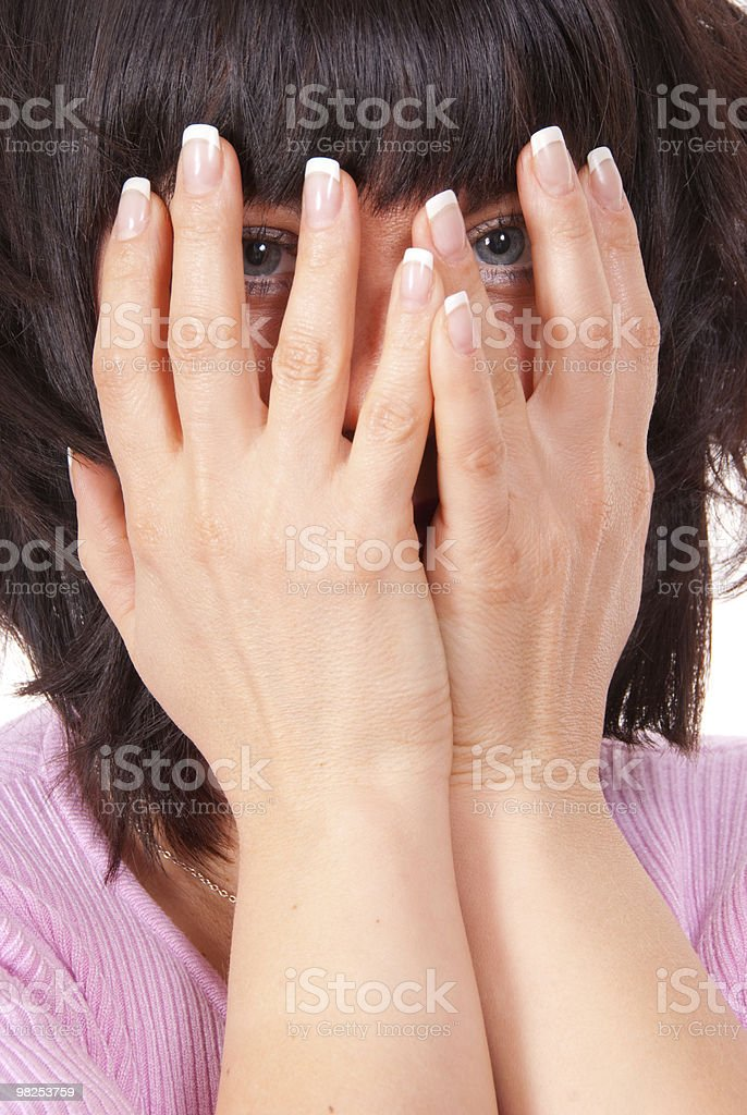 Woman hides her face royalty-free stock photo