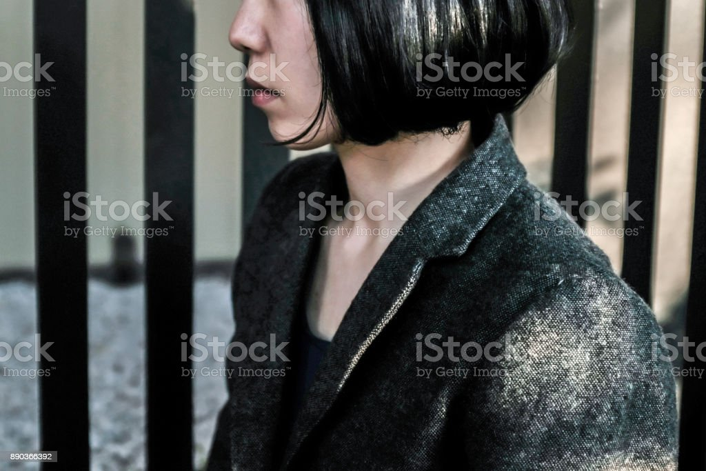 Woman hiding her face stock photo