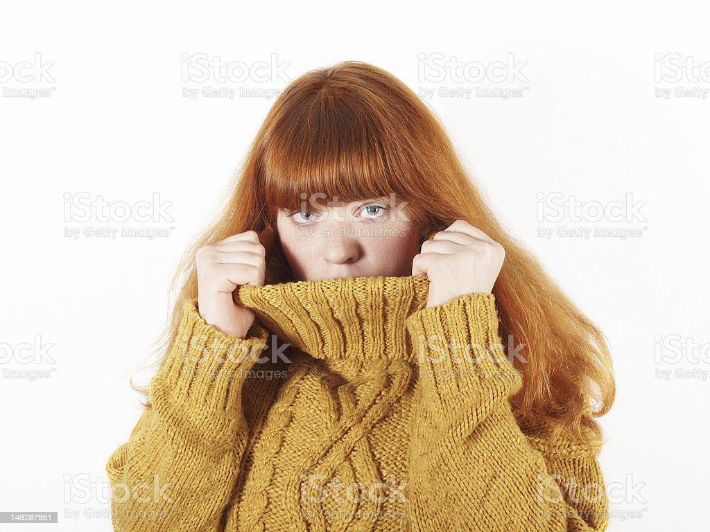 woman hiding in her turtleneck stock photo