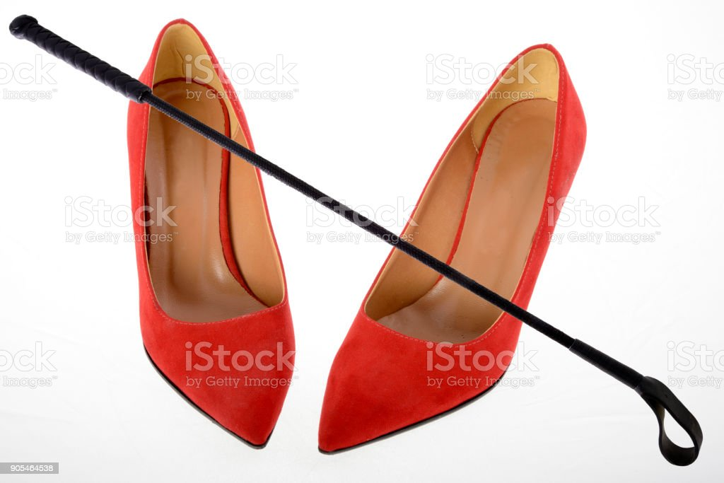 Woman high heels and riding crop stock photo