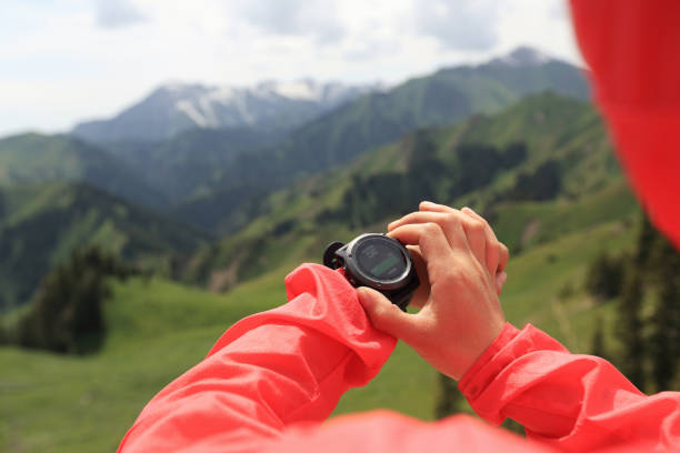 Woman hiker checking the altimeter stock photo