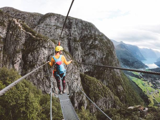 Woman hiker enjoying the view - Loen, Norway stock photo