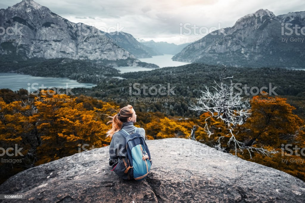 Woman hiker enjoys the valley view stock photo