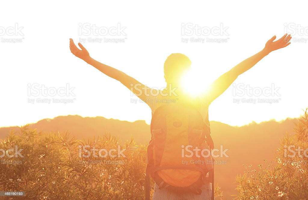 woman hiker excited with sunrise stock photo