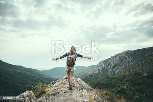 istock Woman hiker on mountain 665992456