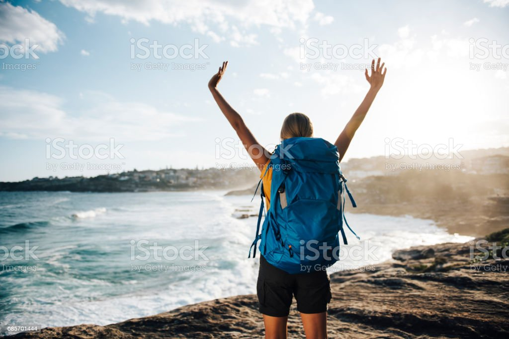 Woman hiker open her arms to the nature royalty-free stock photo