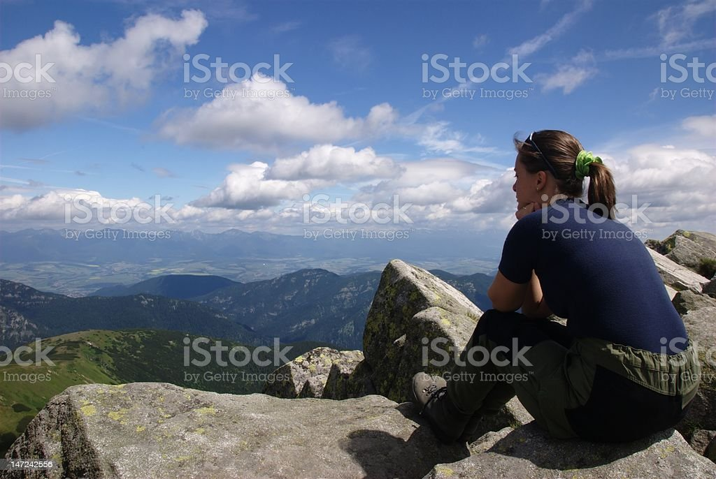 Woman hiker relaxes in mountains royalty-free stock photo