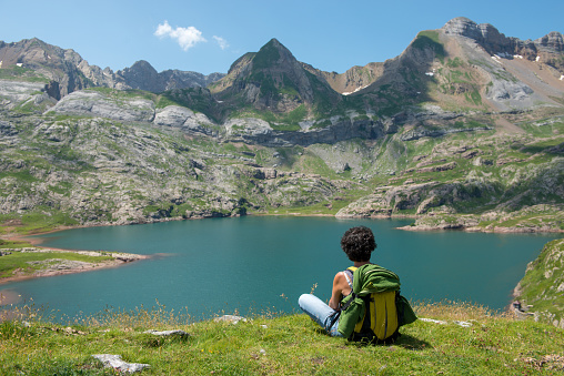 Woman Hiker Resting And Looking At Lake In The Pyrenees Mountains Stock Photo - Download Image Now
