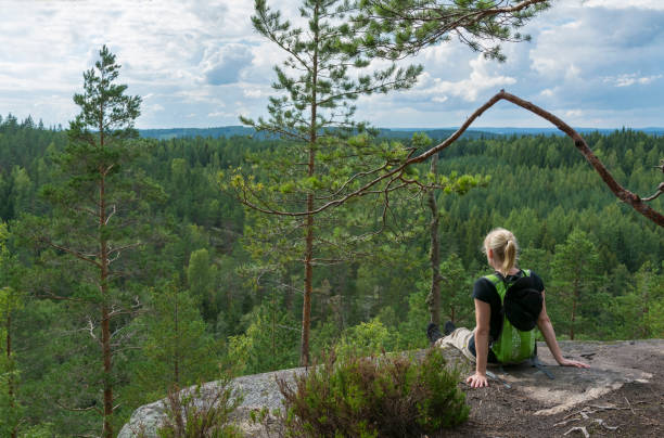 Woman hiking and looking at view stock photo