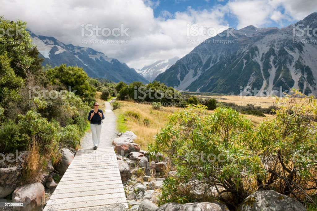 Woman hiking at Mount Cook of the Southern Alps in New Zealand