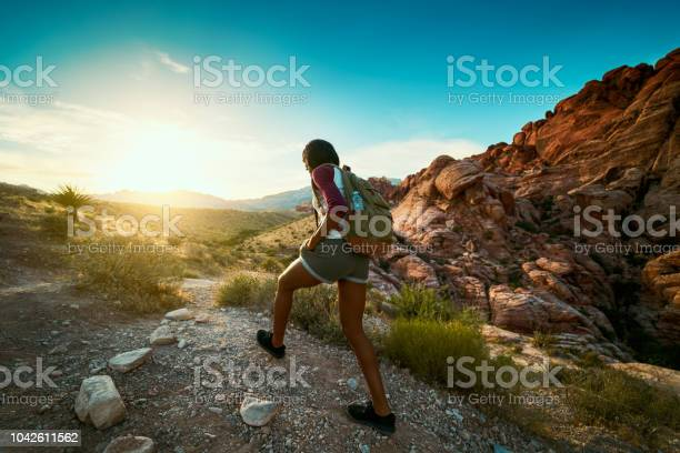 Woman Hiking At Red Rock Canyon During Sunset With Backpack Stock Photo - Download Image Now