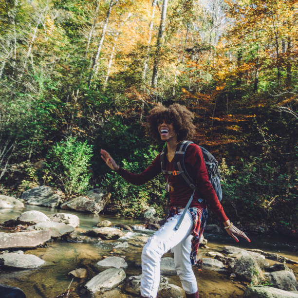 woman hiking by the river stock photo