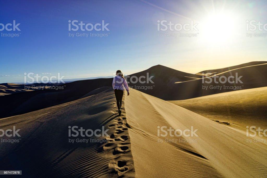 Woman Hiking Great Sand Dunes Colorado stock photo