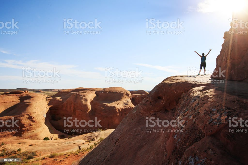 Woman Hiking In Arches National Park Delicate Arch Stock