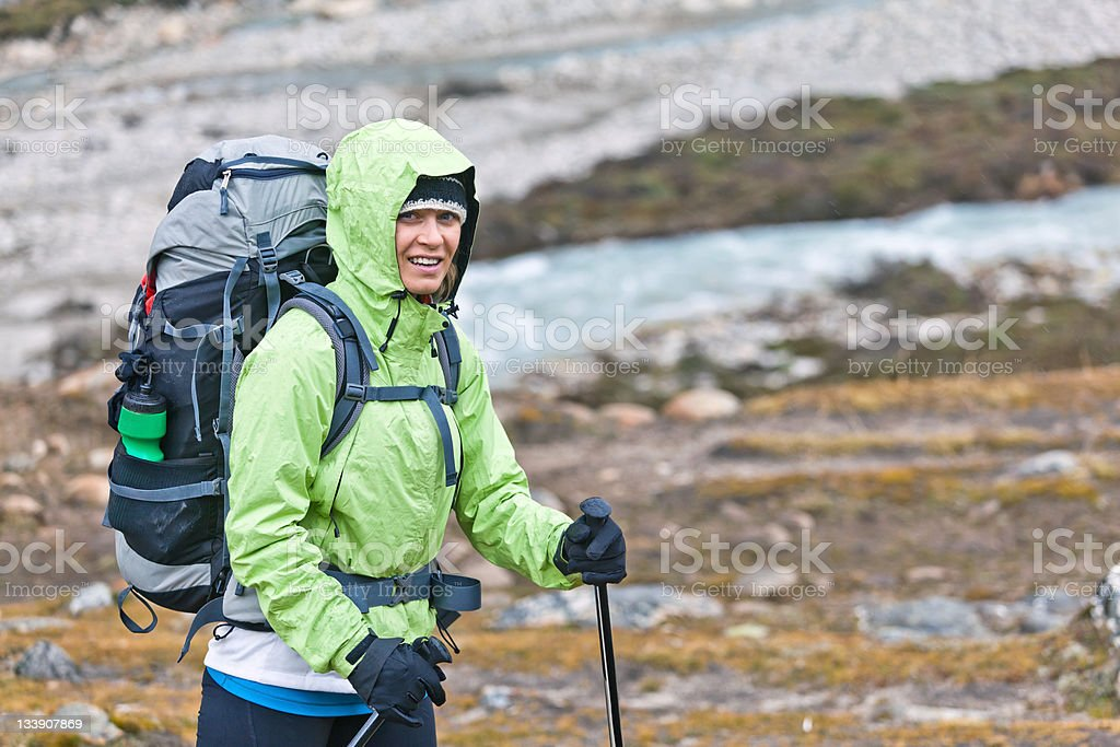 Woman hiking in autumn mountains stock photo